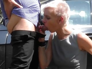 Brief Haired Blonde In Boots With High High-heeled Shoes Is Sucking Manmeat In A Public Place