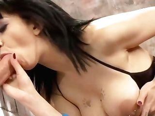 Hot Dark-haired In Blue Fishnets Is Pawing Her Beaver And Sucking Dick Thru A Gloryhole