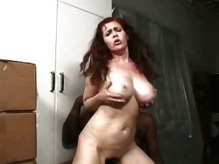 Ginger Cougar Gives Tit Fucking To Well Talented Black Neighbor